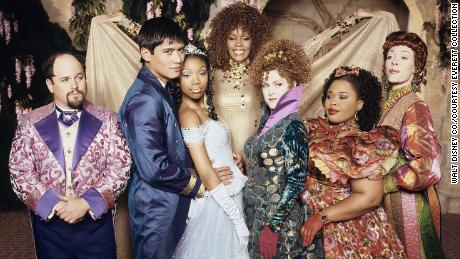 "(From left) Jason Alexander, Paolo Montalban, Brandy, the late Whitney Houston, Bernadette Peters, the late Natalie Deselle Reid and Veanne Cox led the cast in ""Rodgers & Hammerstein's Cinderella."""