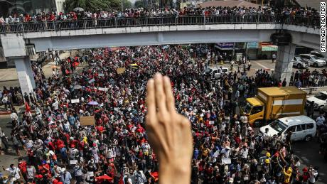 A demonstrator shows the three-finger salute as people rally in a protest against the military coup in Yangon, Myanmar, on February 7.