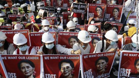 Civil engineers hold placards calling for the release of State Counselor Aung San Suu Kyi during a protest against the Myanmar military coup, outside the US Embassy in Yangon on 17 February 2021.