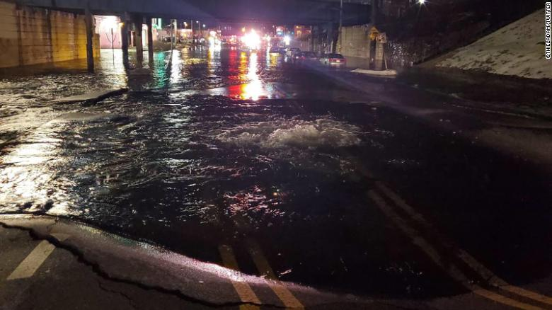 11 people were rescued by boat after a water main break in Philadelphia