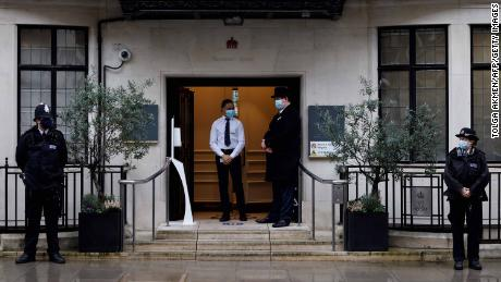 Police stand guard outisde the entrance to King Edward VII hospital in central London where Prince Philip was admitted on Tuesday.