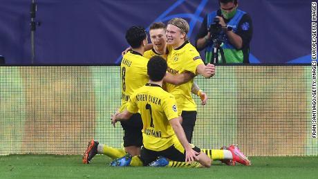 Erling Haaland celebrates scoring his second goal against Sevilla on Wednesday.