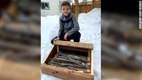 Jeremiah Carter with the stick library he built with his father, David Carter.