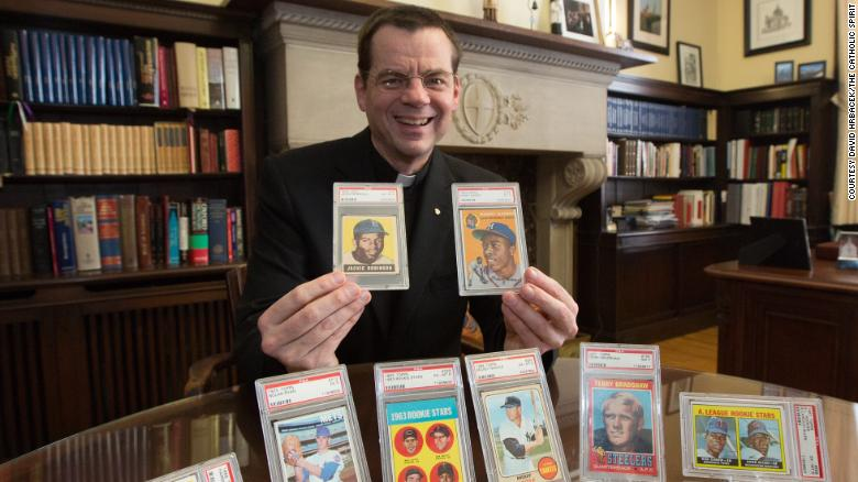 Minnesota priest auctions off baseball card collection for charity