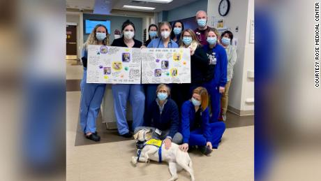 Staff members at the Rose Medical Center in Colorado with their special friend