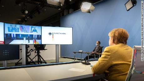 German Chancellor Angela Merkel during Friday's virtual Munich Security Conference with Biden and French President Emmanuel Macron on screen.