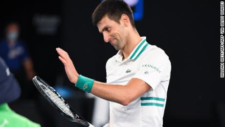 Djokovic applauds Medvedev's stunning drop shot.