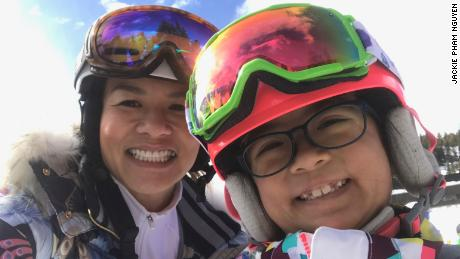 Olivia Nguyen (right), 11, loved skiing with her mom, Jackie Nguyen.