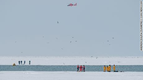 The stranded groups were rescued Sunday after they became separated on two ice floes in Lake Erie.