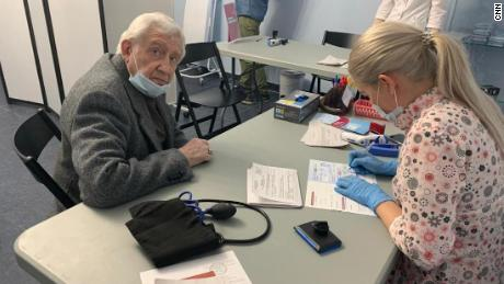 Vadim Svistunov, 84, got both his initial vaccine shot and the booster at an opera house.