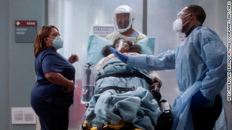 "A scene from an episode of ""Grey's Anatomy"" that aired in December 2020. The series has tackled the pandemic head on."
