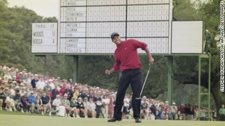 Tiger Woods of the United States celebrates after sinking a 4 feet putt to win the 1997 US Masters Golf Tournament in Augusta, Georgia, United States.