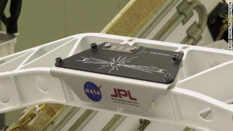 """A placard commemorating NASA's """"Send Your Name to Mars"""" campaign is on the rover."""