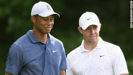 McIlroy (right) and Woods wait on the first tee during the third round of The Northern Trust.
