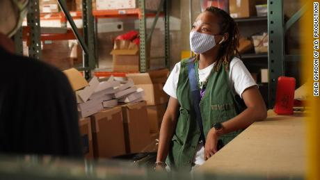 Kearra Johnson delivering the Revolution Card Decks to the Made in KC warehouse.