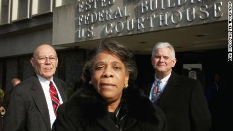 Rita Sanders Geier, center, is shown outside federal court in Nashville on January 4, 2001, a day before the consent decree was approved.