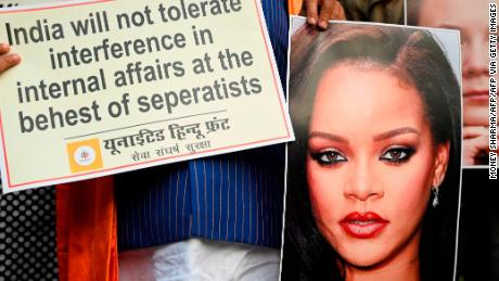 Members of the nationalist United Hindu Front hold an image of singer Rihanna during a demonstration in New Delhi on February 4.