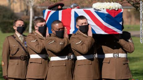 The coffin of Captain Sir Tom Moore is carried by members of the Armed Forces during his funeral at Bedford Crematorium Saturday