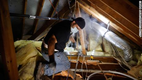 Plumber Randy Calazans with One Call Plumbing repairs a burst pipe in a home on February 21, 2021 in Houston, Texas.