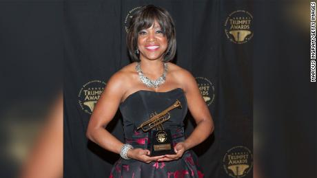 Dr. Valerie Montgomery Rice holds her award during the 23rd Annual Trumpet Awards on January 24, 2015 in Atlanta.