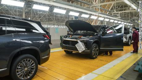 Employees making checks at an inspection line during a media tour of the Nio production facility in Hefei, Anhui province, China, last December.