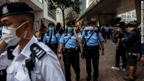 Police patrol outside court in Hong Kong on Tuesday.