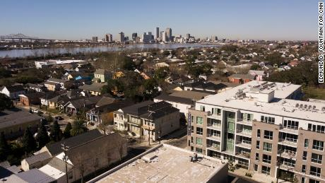The Saxony, a luxury condominium complex in the Bywater neighborhood of New Orleans, broke ground in 2019. Units in the building can cost up to $645,000 and can be used as short-term rentals. In the aftermath of Hurricane Katrina, housing prices in New Orleans neighborhoods near the Mississippi River began rising in part due them being built on some of the highest ground in the city, drastically altering the demographics of some neighborhoods along the river. Edmund D. Fountain for CNN