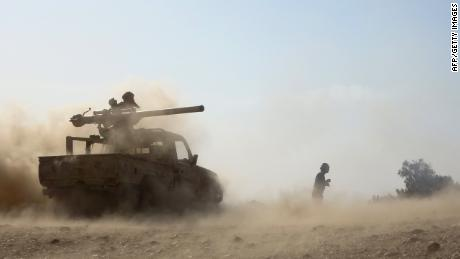Saudi-backed government troops repel Houthi rebels advancing on oil-rich Marib in February.