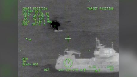 Images released by the US Coast Guard show a rescue helicopter over the stricken vessel Tuesday night.