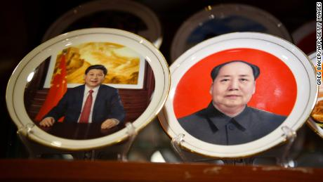 Souvenir plates featuring Chinese President Xi Jinping (L) and late communist leader Mao Zedong are seen at a store in Beijing on March 2,