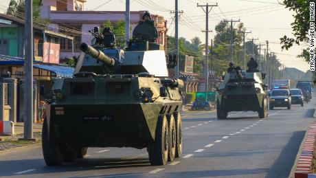 Soldiers ride in military armoured vehicles in Myitkyina, Kachin state on February 3,.