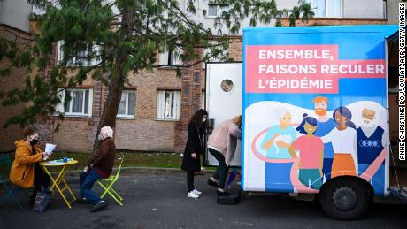A woman enters a truck to receive a dose of Covid-19 vaccine outside her residential building in the Paris suburb of Stains on March 2.