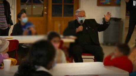 Father Roy Snipes addresses migrants at the Our Lady of Guadalupe church in Mission, Texas.