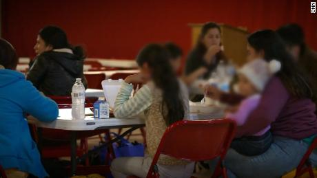 Newly arrived migrants get something to eat at the overflow shelter set up at Our Lady of Guadalupe in Mission, Texas