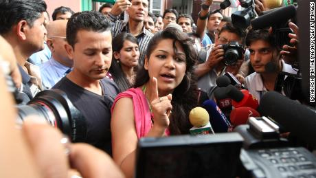 Sobhraj's wife, Nihita Biswas, speaks with media outside the Supreme Court in Kathmandu on July 30, 2010.