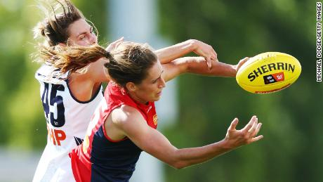Phillips of the Demons (R) and Rheanne Lugg of the Crows compete for the ball during the round two AFLW match between the Melbourne Demons and the Adelaide Crows at Casey Fields on February 10, 2018 in Melbourne, Australia.