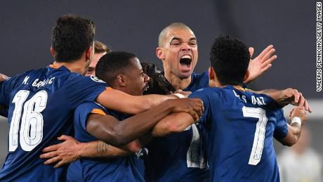 Oliveira celebrates with teammates after scoring their side's second goal against Juventus.