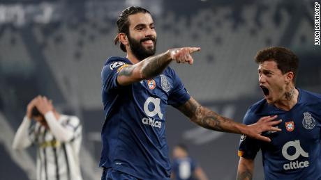 Oliveira celebrates with Otavio (right) after scoring the opening goal against Juventus.