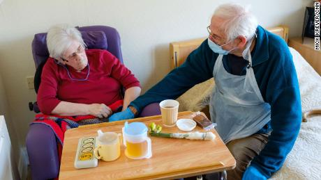 They can only hold hands, but for Britain's elderly, first touch with a relative 'means everything'