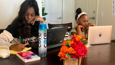 Keilah, left, and her little sister Carson attend classes online.