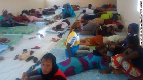Students of the Federal College of Forestry Mechanisation in Kaduna, northwest Nigeria, pictured in Nigeria Defence Academy barracks after fleeing from gunmen who raided their school in the early hours of Friday morning. Thirty students are still missing, authorities say.