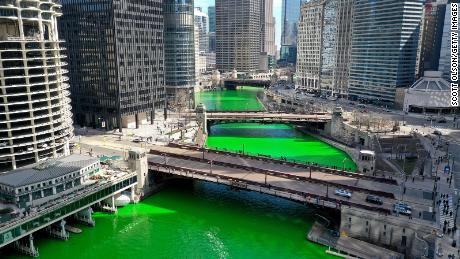 Chicago surprises the city with the traditional green river for St. Patrick's Day after saying the event was canceled