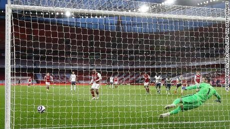 Lacazette shoots from the penalty spot to score his team's second goal.