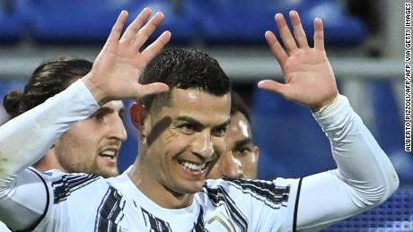 Cristiano Ronaldo celebrates after scoring his third goal against Cagliari.