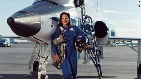 Retired astronaut Joan Higginbotham in front of a NASA T-38 trainer in 2003.