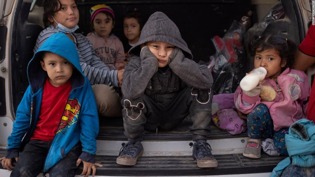 Migrant children from Central America sit in the back of a US Border Patrol vehicle as they wait to be transported on March 14. They had just crossed the Rio Grande on a raft, traveling from Mexico into Penitas, Texas. Pictured in the front row are Yoandri, 4; Miguel, 5; and Yojanlee, 2, all from Honduras.