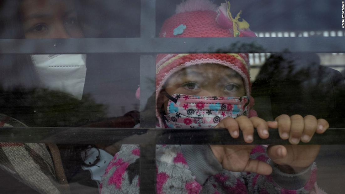 Yaretsi, a 4-year-old from Honduras, sits on the lap of her mother, Angie, while looking out the window of a US Border Patrol vehicle on March 15. They had just crossed the Rio Grande on a raft.
