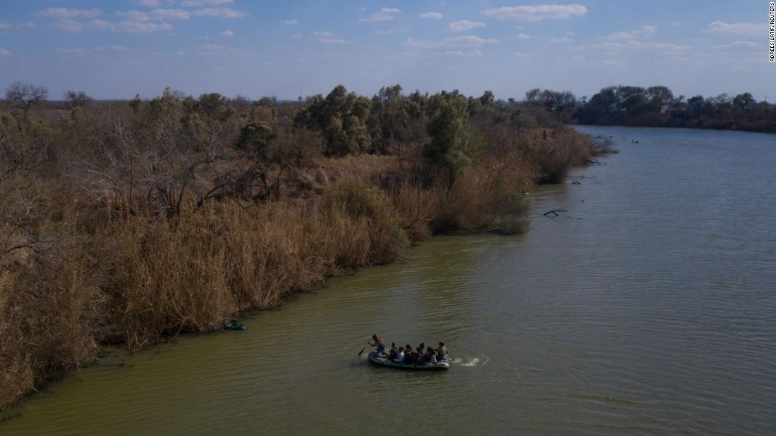 Smugglers use a raft to transport migrant families and children across the Rio Grande into Texas on March 6.