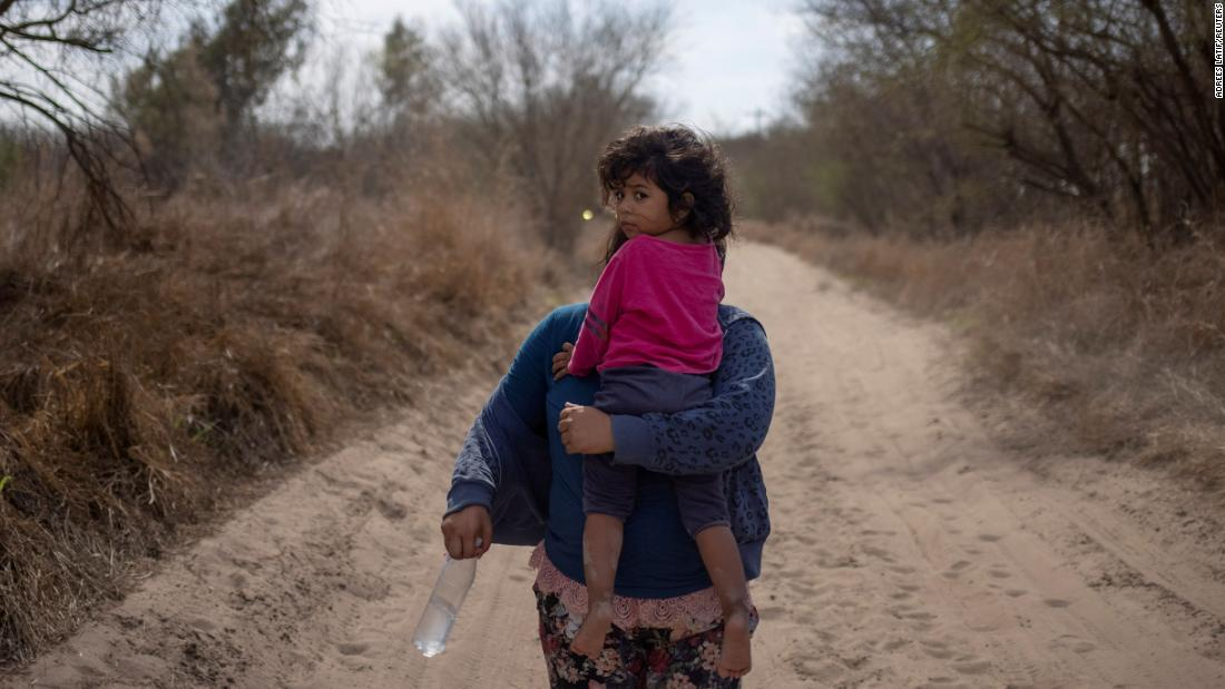 Maria, a 4-year-old from El Salvador, is held by her mother, Loudi, after they crossed the Rio Grande on March 5.
