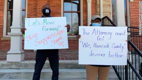 Charles Jackson, left, and Barbara Reynolds protest last week at the county courthouse in Sparta.